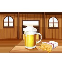 A mug of cold beer and french fries at the saloon vector image vector image