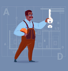 Cartoon african american builder holding key from vector