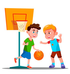 two boys playing basketball on the playground vector image