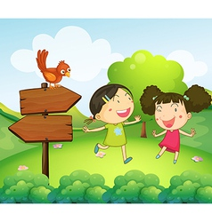 Two girls playing beside the two arrow boards vector image
