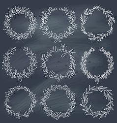 Set of winter wreaths on blackboard vector image