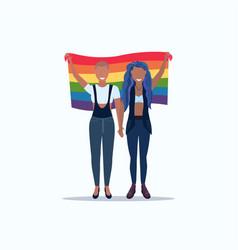 women couple holding rainbow flag love parade lgbt vector image