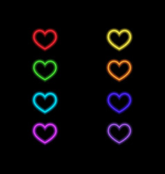 colored neon hearts on a black background vector image
