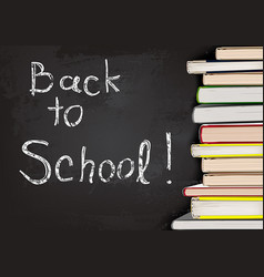 back to school written on chalkboard with books vector image