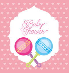 pink and blue toy rattles hearts background baby vector image
