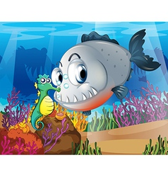 A piranha and a seahorse under the sea vector image vector image