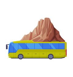 Long tour bus driving along mountain peak as vector