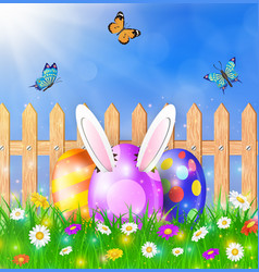 easter eggs on a grass field with flower vector image vector image