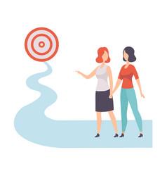 businesswomen walking to path towards to target vector image
