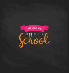 Welcome back to school label on a chalkboard vector