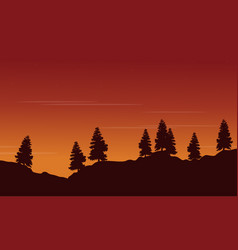 Silhouette of tree lined with orange sky scenery vector