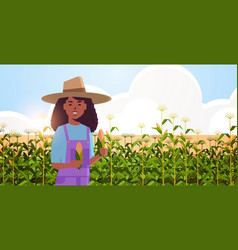 Woman farmer holding corn cob african american vector