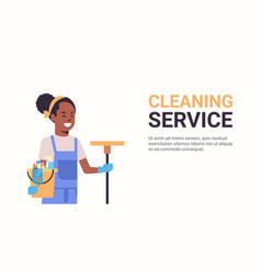 Woman janitor holding bucket with tools and mop vector