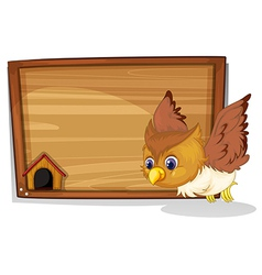 An owl flying near the wooden board vector image