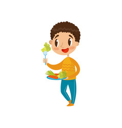 Cute boy eating vegetables on a plate with fork vector