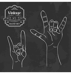 Vintage chalkboard Rock and Roll hand sign vector image