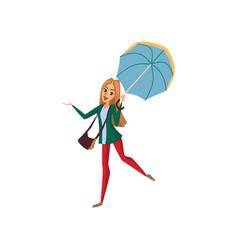 smiling beautiful woman walking under light blue vector image