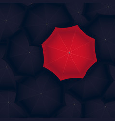 Concept of red umbrella standing out of the black vector