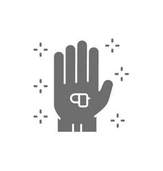 Hearing aid wireless headphones in hand gray icon vector