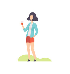 Young woman standing with plastic cup of drink vector