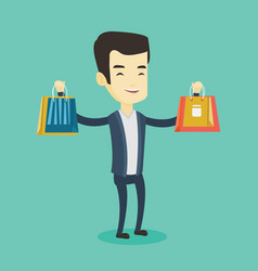 happy man holding shopping bags vector image