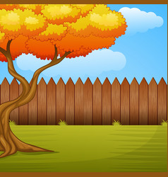 garden background with autumn tree and wooden fenc vector image