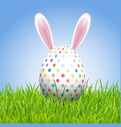 easter background with bunny ears and egg in grass vector image