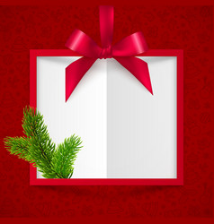 Red silky ribbon with bow and fir tree branch vector image