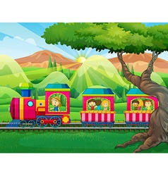 Children riding on the train vector