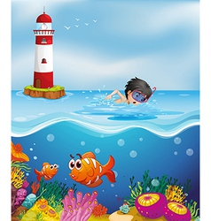 A boy swimming at the beach near the lighthouse vector image