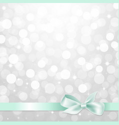 silver glitter bokeh with bow vector image vector image
