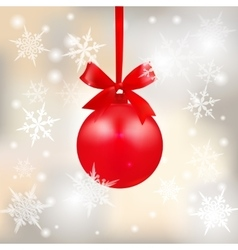 Red shiny ball with a bow on a beautiful Christmas vector