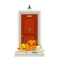 front door with halloween pumpkins and sweets in vector image