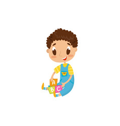 little boy sitting on the floor and playing with vector image