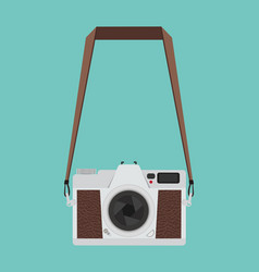 flat style vintage camera hanging on a green vector image