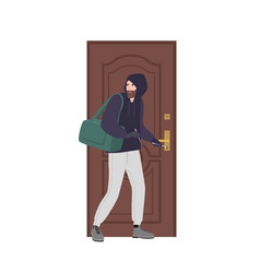 male burglar wearing hoodie trying to unlock door vector image