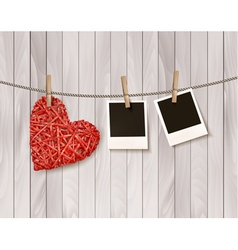 Red wooden heart with photographs vector image