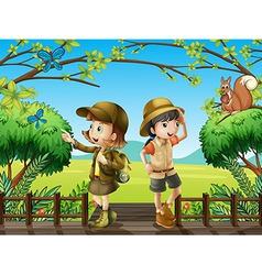 A girl and a boy at the wooden bridge vector