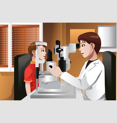 boy having his eyes checked at the doctor office vector image