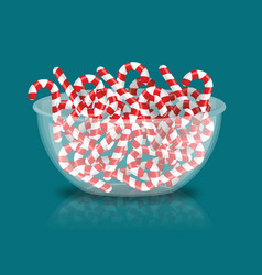 Mint christmas candy in bowl peppermint stick vector