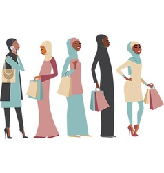Muslim girls holding shopping bags vector
