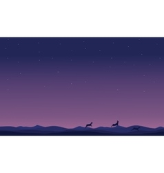 Silhouette of deer at night landscape vector