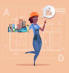 Cartoon female builder holding small house ready vector