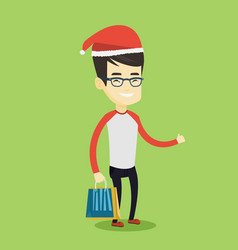 man in santa hat shopping for christmas gifts vector image