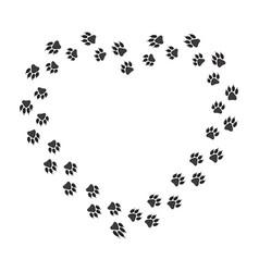 Black paw print in love shape vector