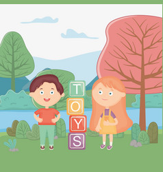 girl and boy with alphabet blocks in park vector image