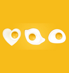 fried eggs in heart shape top view vector image
