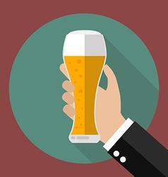Glass of beer in hand vector image vector image
