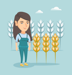 Young caucasian farmer standing in a wheat field vector