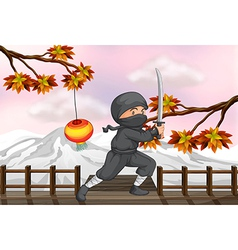 A ninja with a sword vector